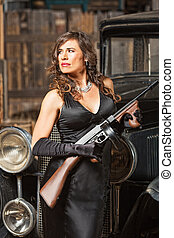 Confident Gangster Woman with Gun - Confident 1920s vintage...