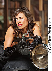 Smirking Woman with Machine Gun - Smirking woman in black...