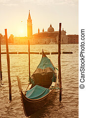 Sunset view of Venice with gondola on Grand Canal