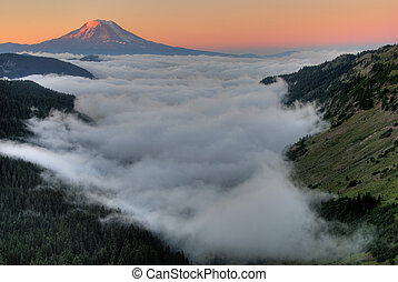 Mt. Adam sunrise with clouds. - Clouds tucked around Mt....
