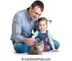 kid girl and her dad play with cat kitten