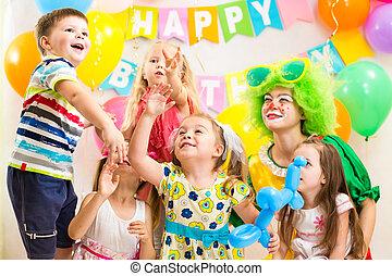children celebrating   merrily birthday party