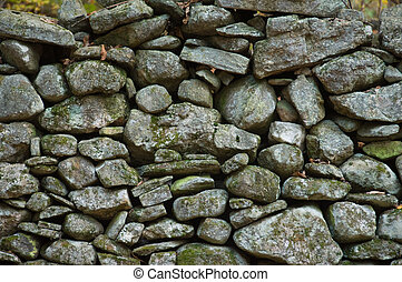 Rock wall, New England - Rock wall running through an autumn...