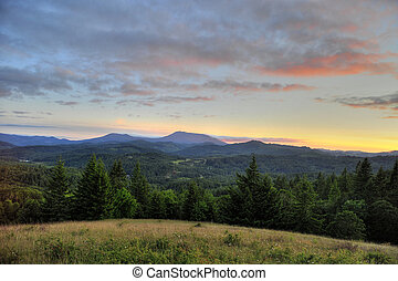 Sunset over mountain range - Sunset over Marys Peak in the...