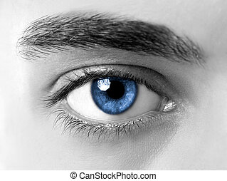 Blue eye - Close-up picture of blue eyes from a young man