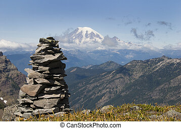Cairn on a mountain trail - Mountain cairn with Mt. Adams in...