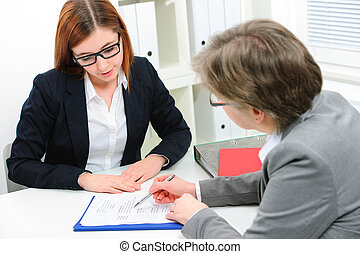 Job applicant having an interview - Young woman discussing...