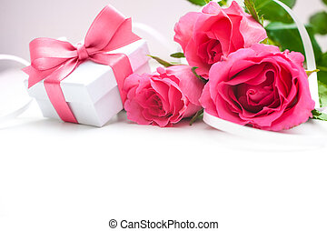 Bouquet of roses and gift box on white background