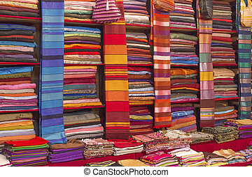 Colorful fabrics for sale on a market in Morocco