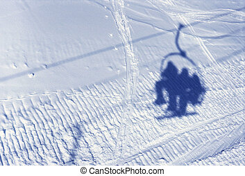 Shadow of ski lift and people on snow - View upon Shadow of...