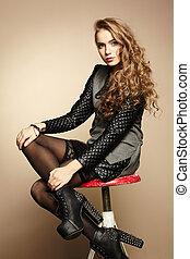 Portrait of beautiful girl in modern dress