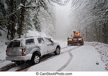 Auto accident in the snow - Car being towed after accident...