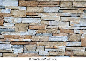 Textured brickwork - A wall of pale sandstone bricks, good...