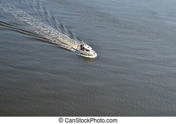 motor boat and small waves - motor boat at sea and many...