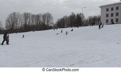 people sledge hill - fun people leisure winter time on the...