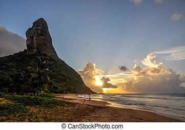 Sand beach and Morro do Pico at sunset, Fernando de Noronha...