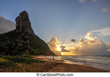 Sand beach and Morro do Pico at sunset, Fernando de Noronha...