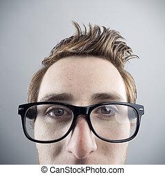Nerd portrait - Portrait of young Nerd businessman looking...