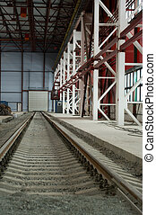 Railroad going into the distance on hangar