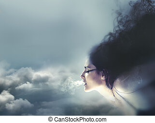 Nature concept, clouds and wind Beautiful brunette, Healthy...