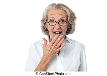 Amazed senior citizen - Old Woman with surprised expression...
