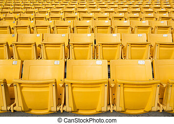 Front of the yellow seats on the stadium