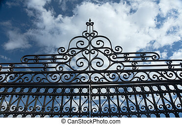 Old Wrought Iron Fence and Blue Sky - An intricate old...