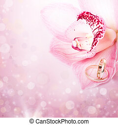 Pink orchid and wedding ring