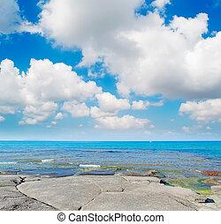 Lu Bagnu clouds - clouds over Lu Bagnu shore