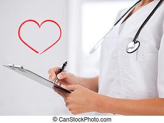female doctor with stethoscope and prescription - healthcare...