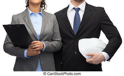 businesspeople with clipboard and helmet
