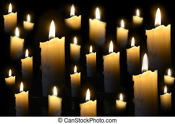 Burning candles on the dark - Group of burning candles on...