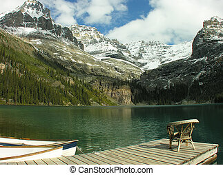 Chair on a wooden pier, Lake OHara, Yoho National Park,...