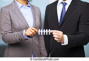 businessman and businesswoman holding paper team - business...