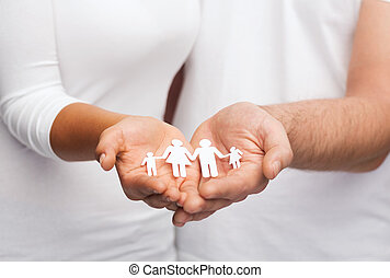 couple hands with paper man family - love and relationships...