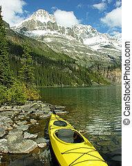 Yellow kayak at Lake O'Hara, Yoho National Park, Canada -...