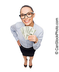 smiling businesswoman with dollar cash money - business,...