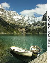 Wooden boats at Lake O'Hara, Yoho National Park, Canada -...