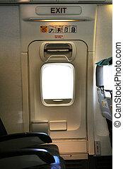 Emergency exit door. - Emergency exit row. Passenger cabin...
