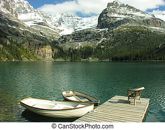 Wooden boats at Lake O'Hara, Yoho National Park, Canada -...