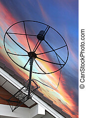 Satellite dish Stuck to roof of house on Evening light - The...