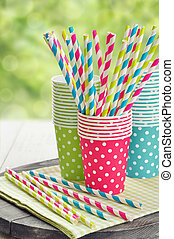 Paper cups and striped straws - Colorful paper cups and...