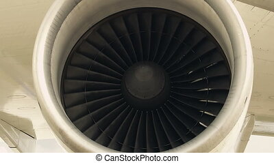 Jet engine of an airplane - Zoom out - jet engine of an...