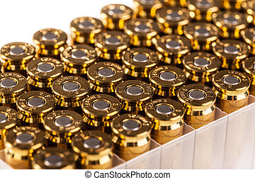 Bullet box - a pack full of unused 9mm bullets isolated on...