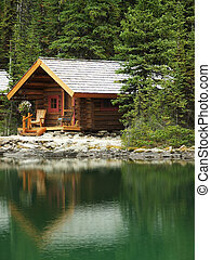 Wooden cabin at Lake O'Hara, Yoho National Park, Canada -...