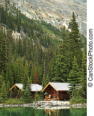 Wooden cabins at Lake O'Hara, Yoho National Park, Canada -...