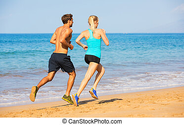 Couple running on the beach - Couple running. Sport runners...