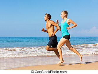 Couple running on the beach - Couple running Sport runners...