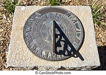 Sundial - A sundial telling the time of day, approximately...