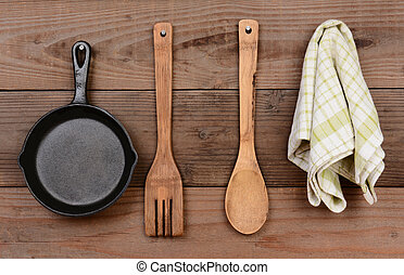 Kitchen Utensils - Closeup of a cast iron frying pan and...